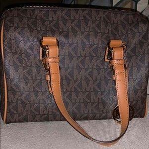 Gently used designer Michael Kors handbag
